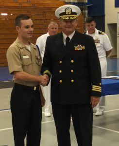 Cadet Chief Petty Officer Jacob L. Greenwood receives the H. L. Hunley JROTC Medal